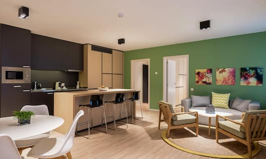 2 Bedroom Suite Showing Lounge, Sofa And Kitchen
