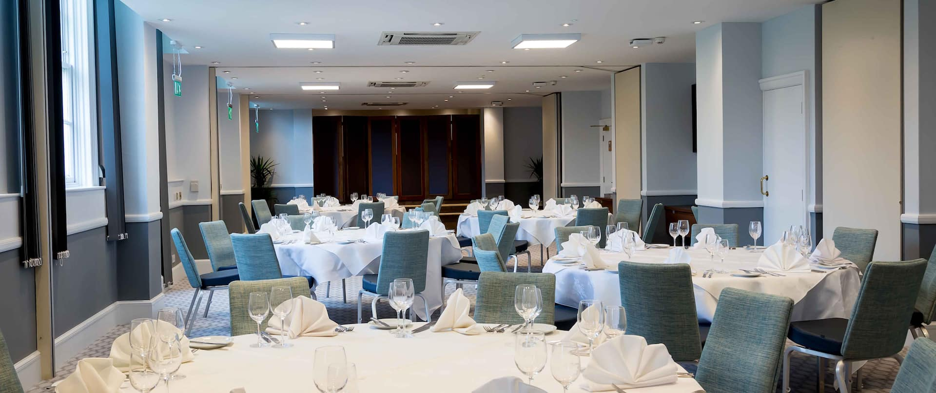 Meeting Room with Round Decorated Banquet Tables