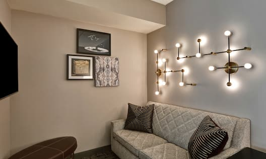 Modern living area with couch and lighting