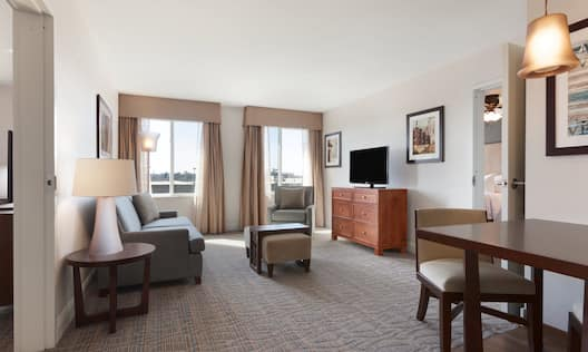2 bedroom suite licing area with chairs and tv