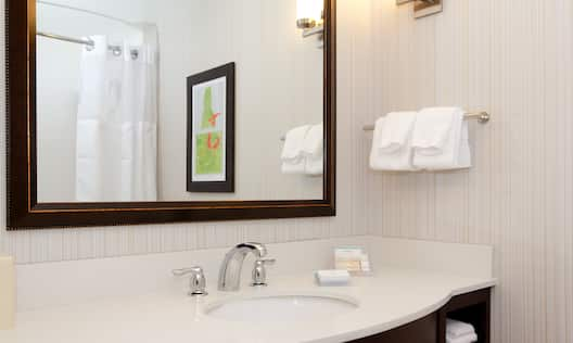 Bathroom with Mirror and Towels