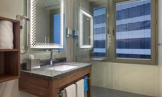 Guest Room Vanity Area with Lit Mirror