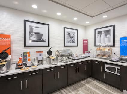 Dining Area with Waffle Irons, Pastries, Toast and Other Hot and Cold Food Options