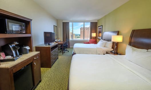 Double Queen sized Bed Guest Room with Microfridge TV and City View