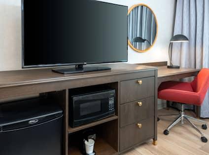 tv with mini fridge and microwave