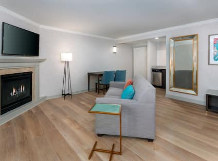 lounge area in king studio suite with fireplace