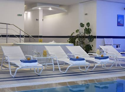 Health Club Indoor Pool and Loungers