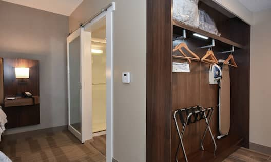 Guest room entrance with open closet.
