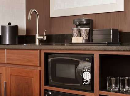 Close-Up of Guestroom Wetbar with Microwave and Coffee Machine