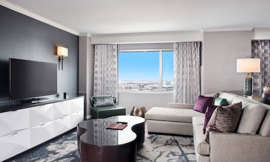 Guest Suite Lounge Area with Sofa, Coffee Table, Armchair, City View and HDTV