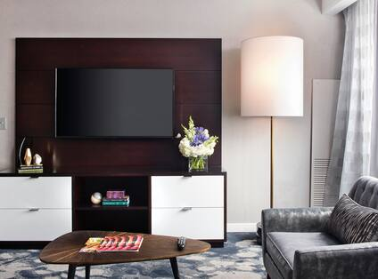 Guest Suite Lounge Area with Sofa, Coffee Table and Wall Mounted HDTV
