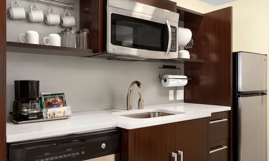 Kitchenette With Full Sink And Microwave