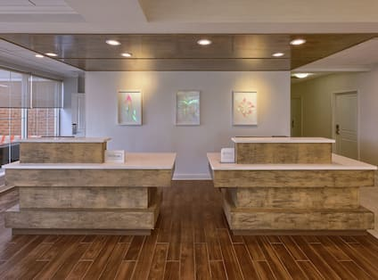 Wall Art Behind Large Wooden Front Desk