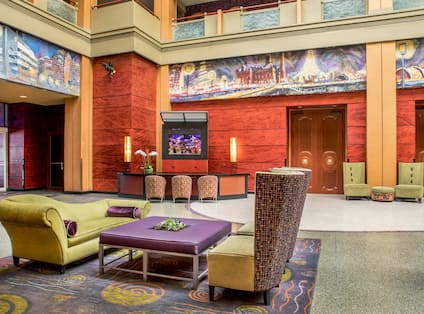 Spacious Lobby Area with Sofa, Chairs, and Table
