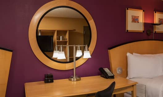 Guest Room Work Desk with Lamp and Circular Mirror