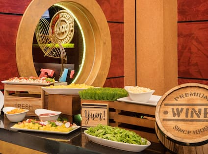 Various Food Dishes with Wooden Wine Barrel