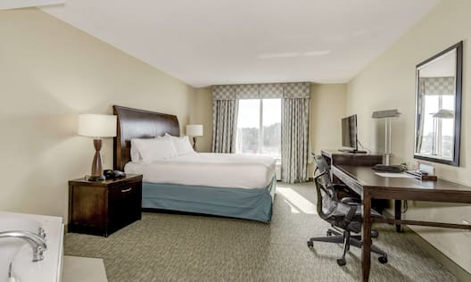 King bed in Jacuzzi Room with desk and TV
