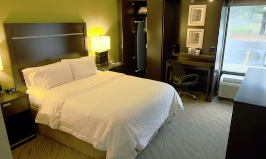 Guest Room with Large Bed and Work Desk
