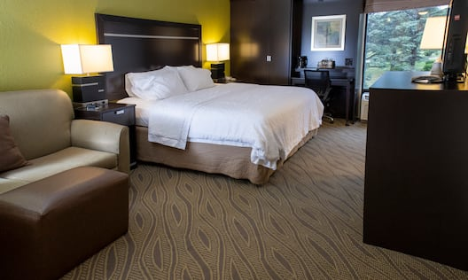 Large Bed and Sofa in Hotel Guest Room