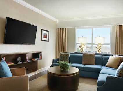 Living Room with a Large Sofa a Round Coffee Table and an HDTV