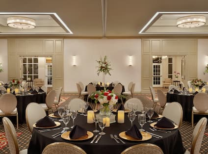 Hilton Ballroom with Round Tables and Chairs