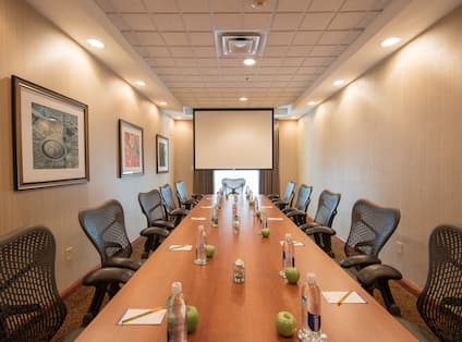 Boardroom with Large Meeting Table, Office Chairs and Projector Screen