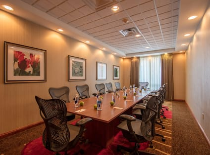 Boardroom with Large Meeting Table and Office Chairs