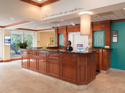 Lobby front desk with receptionist