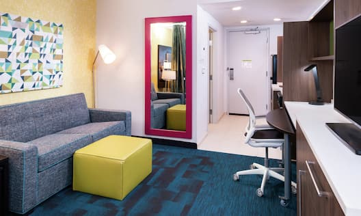 Suite Lounge Area And Work Desk