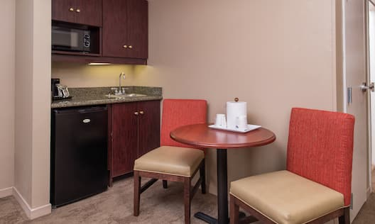 Wet Bar, and Seating for Two at Dining Table in Deluxe Room