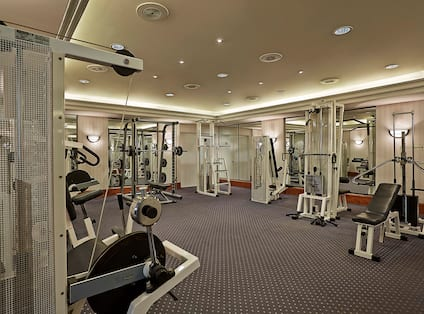 Fitness center with weight machines and free weights