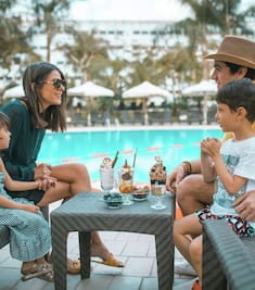 Family Having Ice Cream by the Outdoor Pool Area