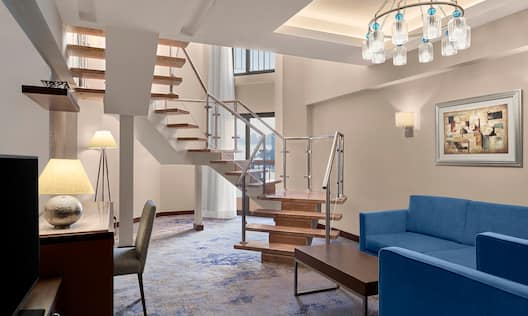Duplex Suite Living Area with Desk on Lower Floor
