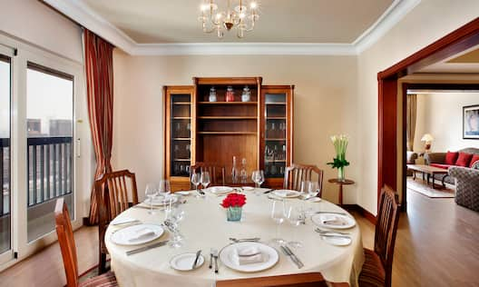 Ambassador Suite Dining Area with table and chairs
