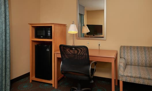 Room Amenities such as Microwave Minifridge Work Desk Chair and Mirror