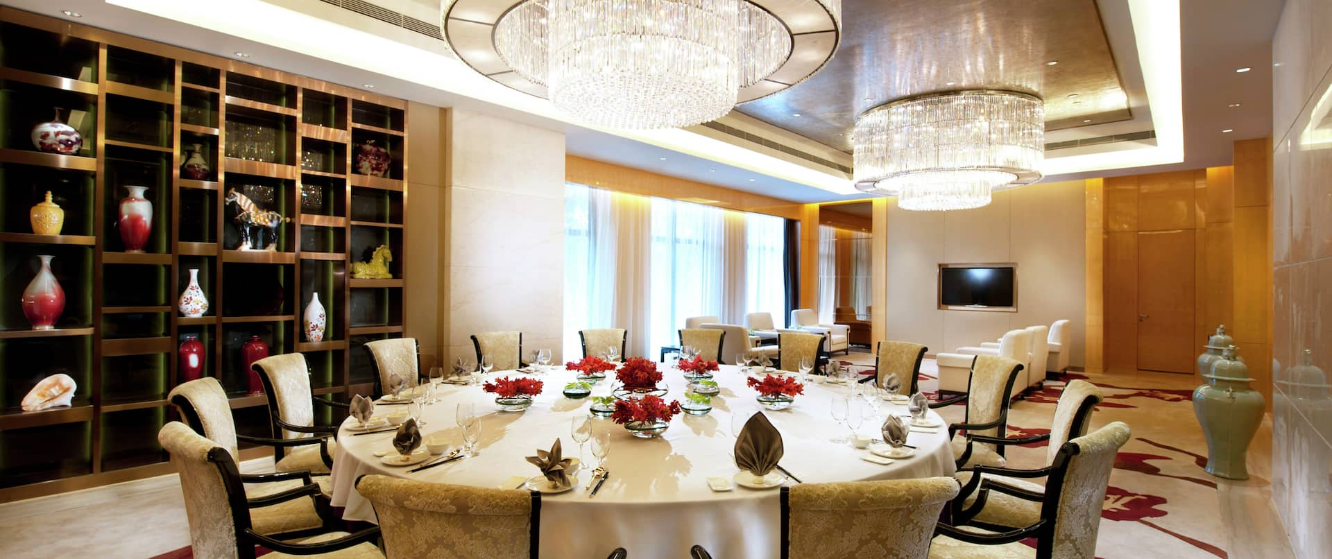 a private dining room with a round table