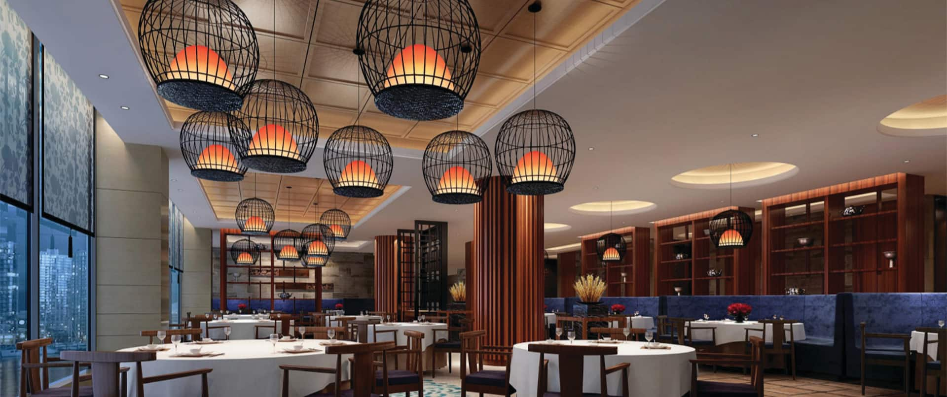 Tables, chairs and hanging lights in a restaurant