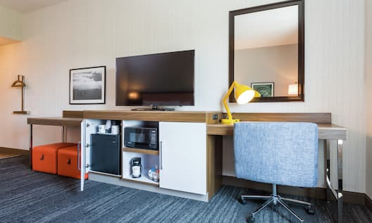 Entertainment area with TV and workdesk