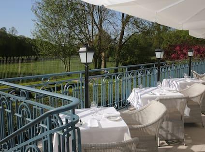Terrace of La Veranda by Gordon Ramsay overlooking hotel grounds