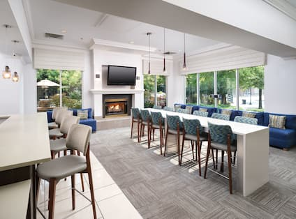 Lobby Area with Large Table TV and Fireplace