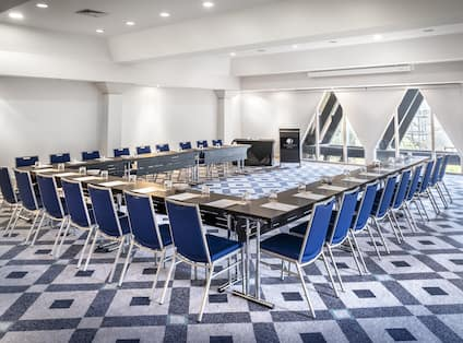 a u-shaped meeting table in a meeting room