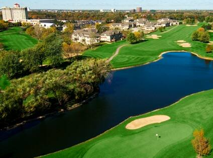 Golf Course Overview with Large Pond