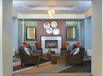 Soft Seating Around Fireplace in Lobby Lounge Area