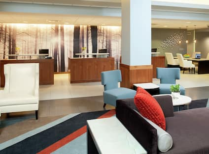 Soft Seating in Lobby Lounge Area With View of Front Desk