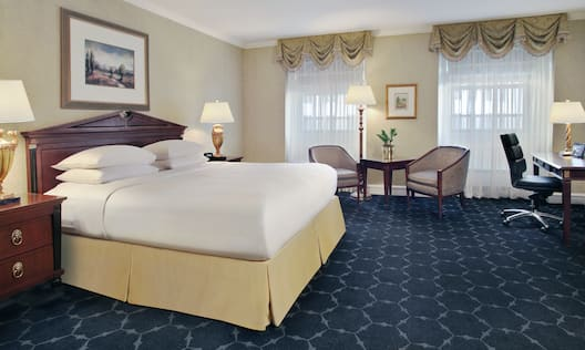 Executive King Bedroom with Bed, Lounge Area, and Work Desk