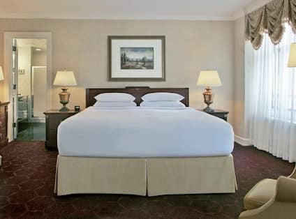 Goldcoast Suite with Bed and Lounge Area with Bathroom View