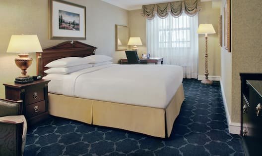 Queen Guestroom with Bed and Work Desk