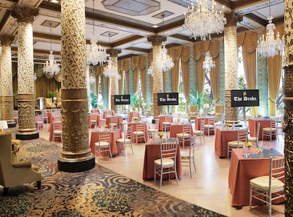 Spacious Ballroom Area with Dining Tables and HDTVs