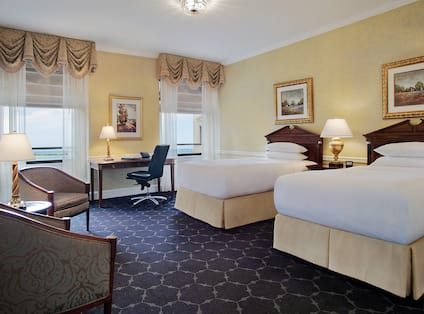 Twin Beds Guest Bedroom with Two Armchairs and Work Desk