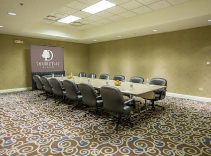 Meeting Room With Presentation Screen and Seating for 12 at Boardroom Table